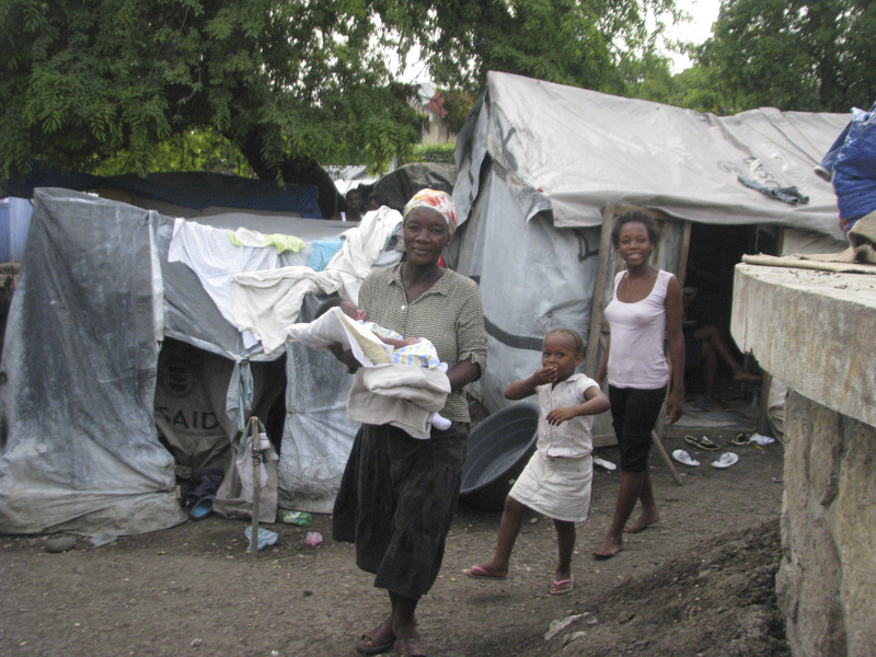 Christa Oviles, 40, holds her baby, Alexandro Joseph, who was born Aug. 15 in a tent city in Port-au-Prince. Oviles saw a doctor only once during her pregnancy and gave birth on the floor inside the squalid encampment. 03000000 08000000 14000000 DIS HUM krtdisaster disaster krtfeatures features krthumaninterest human interest krtnews krtsocial social issue krtworld world SOI krtedonly mct 03002000 13015001 krtquake earthquake quake krtworldnews african american african