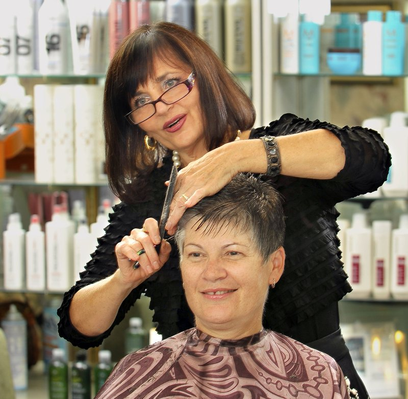 Gordon Chibroski/Staff Photographer Janet Thiboutot, owner of As You Wish, provides Gail Sanborn, a regular client, with her monthly haircut at Thiboutot's salon on Woodford Street in Portland.