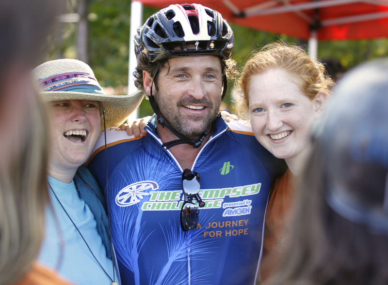 Actor Patrick Dempsey poses for a photo with Shawne McCord, left, and her daughter Lia Wellen, 17, both volunteers from Freeport, at a rest stop in Mechanic Falls. Dempsey stopped periodically along the bike route to meet locals, volunteers and fellow bikers, sign autographs and pose for photographs today.