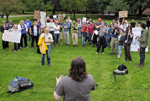 After marching from Monument Square, protesters gather at the University of Southern Maine in Portland to take turns voicing their concerns. The local protest showed solidarity with the weeks-long action on Wall Street.