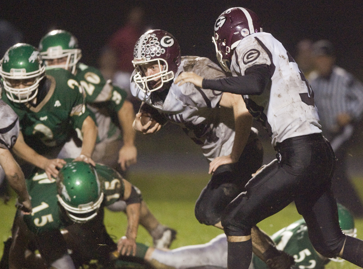 Brad Turnbaugh of Gorham finds a hole and heads to the end zone on a 93-yard run Friday night – part of the 16 combined touchdowns in a 63-47 victory against Massabesic. Gorham gained 607 yards rushing and other than three fumbles, scored on each possession.