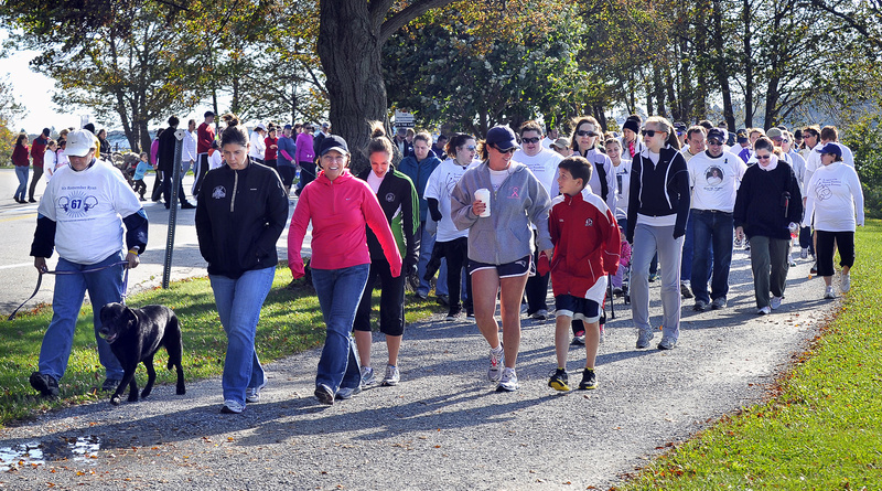 Participants start the Out of Darkness walk Saturday at Back Cove in Portland to benefit the American Foundation for Suicide Prevention. The walk also serves to support those affected by a suicide.
