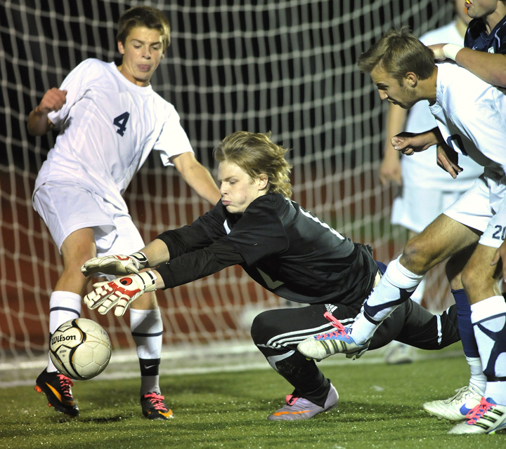 Yarmouth keeper Andrew Fochler dives for a loose ball as defender David Murphy, left, backs him up. Fochler made the start in place of Christopher Knaub, who was injured. Fochler's stepbrother, Nathan Diffin, is York's keeper.
