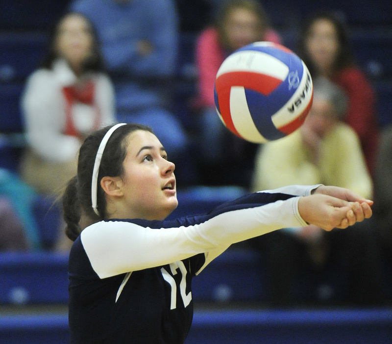 Grace Mallett of Yarmouth sets the ball to a teammate Wednesday during a straight-set volleyball playoff victory against Machias.