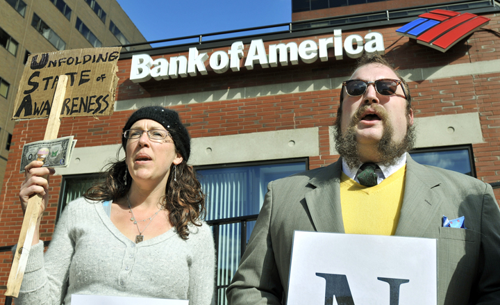 Rebecca Buttignol of York and John Schreiber of Portland protest against Bank of America at One City Center today. The demonstration was organized by Occupy Maine.