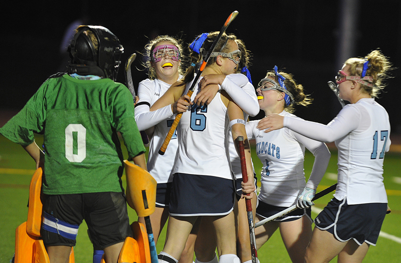 York High's Taylor Simpson is congratulated by Shelby Spencer, 6, Liz Fiorentino, 1, and Victoria Stocks, 17, after scoring the only goal in Tuesday's 1-0 win at Hill Stadium in Saco. Mountain Valley goalie Emily Gallant, who had an excellent game with 14 saves, looks on at left. York will play Belfast in the state final Saturday.