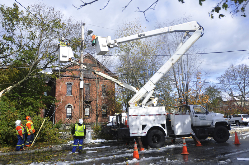 A crew from O'Donnell Line & Electric of Canada works to restore power on Dyer Street in Saco. A transformer was damaged after a tree fell on the line during today's storm causing power outages to the area.
