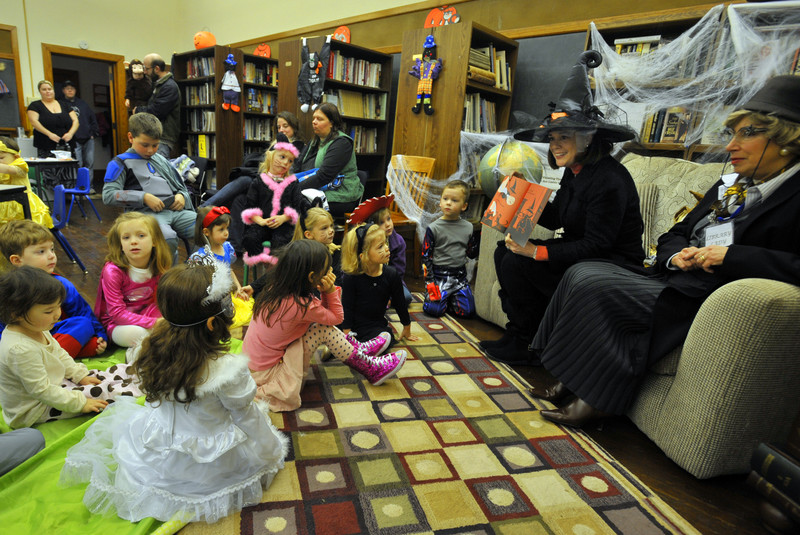 State Senator Lisa Baker reads to children at the Nuangola Library with the Librarian Lina Santomauro. Children attending the Halloween themed reading were treated to activities and a snack as well as stories. 10/29/2011 Aimee Dilger/The Times Leader