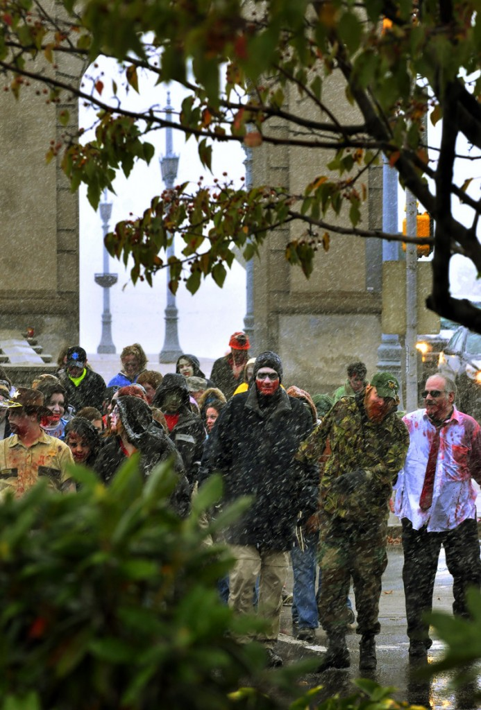 A large group of people dressed as Zombies participated in the 2nd annual zombie walk from Kirby Park to Wilkes-Barres Public Square and back in the snow on Saturday. 10/25/20111 Aimee Dilger/The Times Leader
