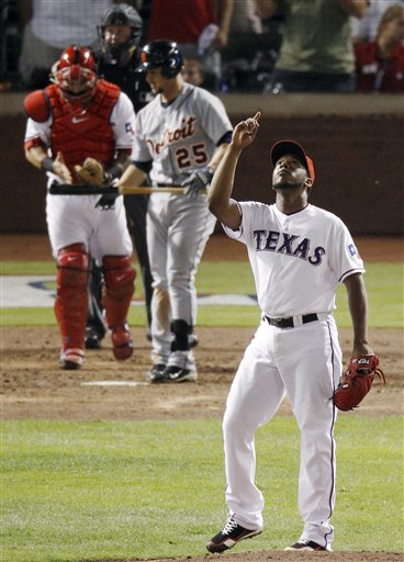 Texas Rangers' Neftali Feliz reacts after striking out Detroit Tigers' Ryan Raburn for the final out of Game 1 at baseball's American League championship series Sunday, Oct. 9, 2011, in Arlington, Texas. Texas won, 3-2. Texas catcher Mike Napoli and home plate umpire Tim Welke are at rear. (AP Photo/Eric Gay)