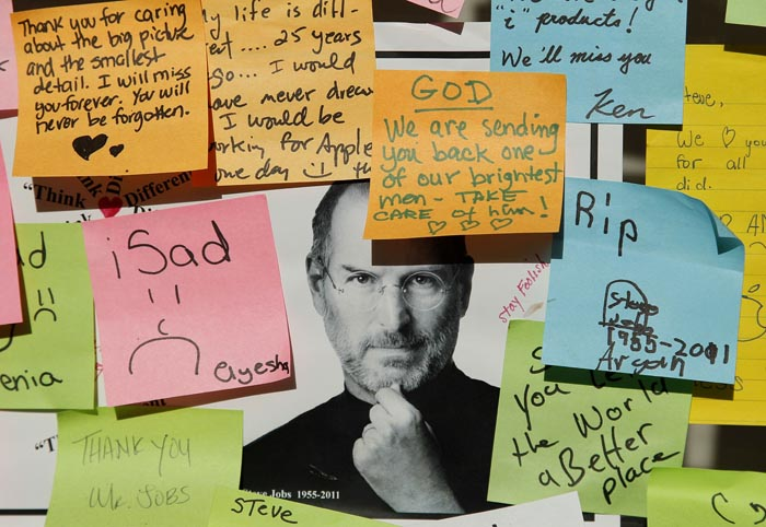 Notes written by mourners of the late Steve Jobs are posted outside an Apple store in Palo Alto, Calif., today.