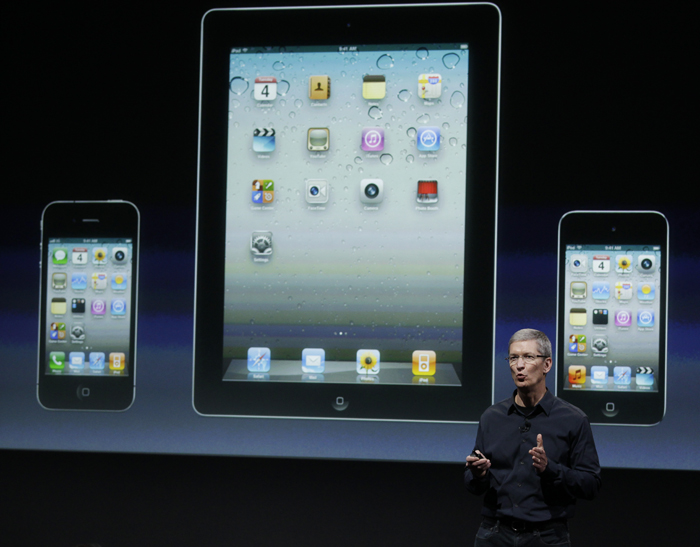 Apple CEO Tim Cook talks about iPhone, iTouch and iPad during a press conference at Apple headquarters in Cupertino, Calif., today.