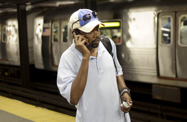 Mory Bailo Aw makes a cellphone call from a subway platform to get some last minute directions to a friends house in New York. A Danish study of more than 350,000 people concluded there was no difference in cancer rates between people who had a cellphone subscription and those who did not.