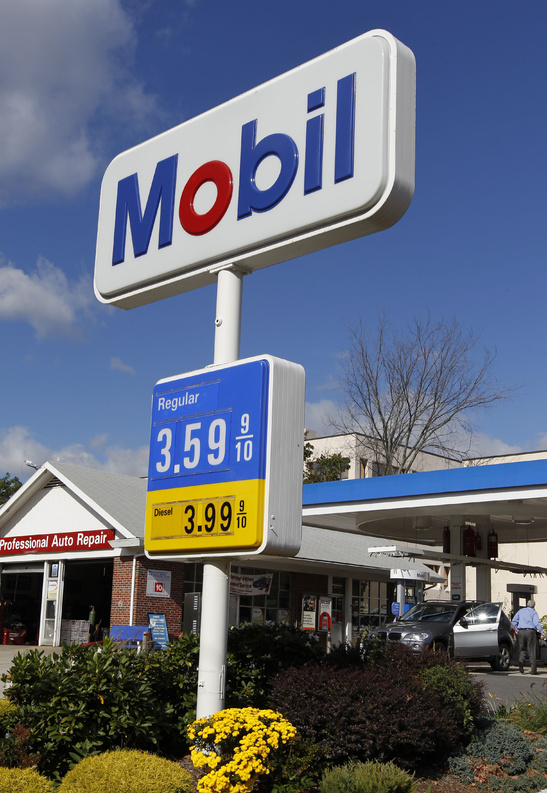 Gas prices are displayed at a Mobil station in Quincy, Mass. Analysts say oil demand may outstrip supply but don't yet fear a price jump like the $147 per barrel crisis in 2008.