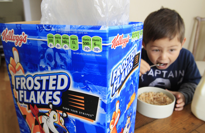 Nathaniel Donaker, 4, eats Kellogg's Frosted Flakes cereal at his home in Palo Alto, Calif.