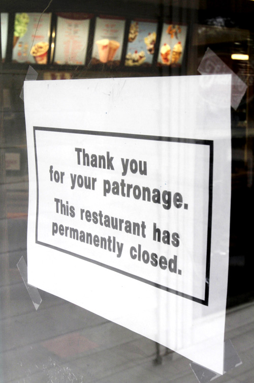 A closed sign is taped to the door of the Friendly's restaurant in Freeport today.