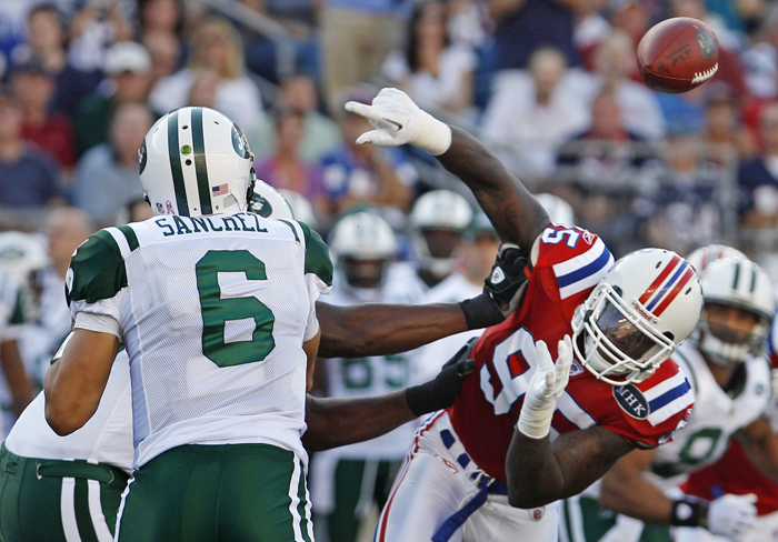 New England Patriots defensive end Mark Anderson, right, pressures New York Jets quarterback Mark Sanchez on a pass during the first quarter of the game last Sunday.