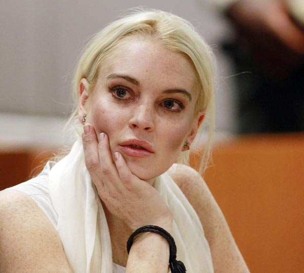 Lindsay Lohan is seen in court today before being taken into custody by Los Angeles County sheriff's deputies when a judge found her in violation of probation.