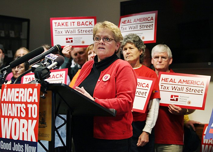 Cokie Giles, a nurse at the Eastern Maine Medical Center, speaks to an audience of about two dozen trades workers, state employees and community members at the State House for a rally to encourage Congress to pass legislation to create jobs.