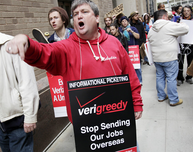 Kevin Condy and other picketing Verizon employees are joined by Occupy Wall Street protesters in front of a Verizon office in New York on Tuesday.