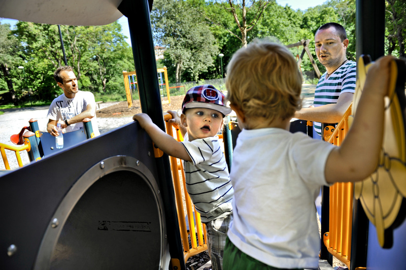 Henrik Holgersson, right, watches his son, Arvid, at center in hat, play with Walter Johansson, accompanied by his father, Henrik Johansson, at a playground in Stockholm.