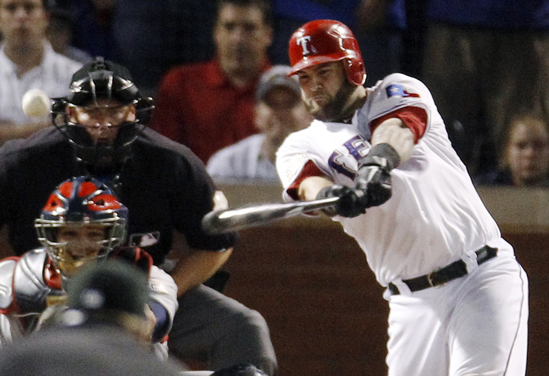 The Rangers' Mike Napoli hits a two-run double off St. Louis pitcher Marc Rzepczynski in the eighth inning Monday night in Arlington, Texas, in Game 5 of the World Series. Texas started its rally with solo homers by Mitch Moreland in the third and Adrian Beltre in the sixth.