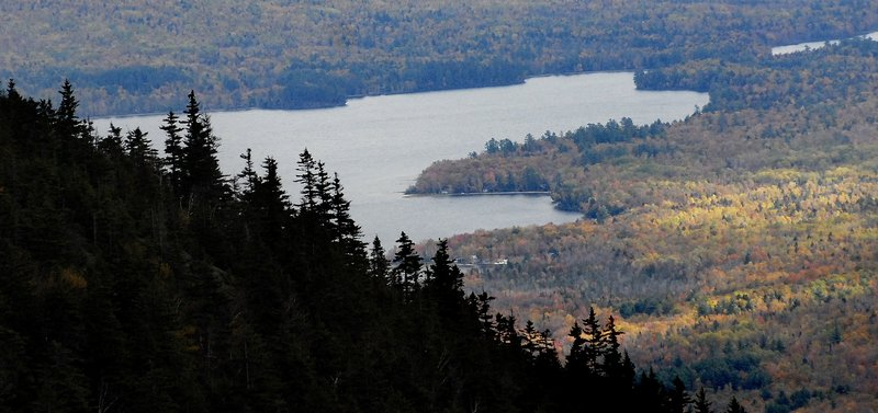 An autumn vista from Tumbledown Mountain, near Weld, includes Webb Lake below and miles of vibrant trees, making it a favorite with many hikers.