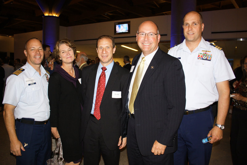 Capt. Christopher Roberge of the U.S. Coast Guard, Elizabeth Roberge, Agent Todd DiFede of the Federal Bureau of Investigation, U.S. Marshal Noel March and Cmdr. Brian Gilda of the U.S. Coast Guard.