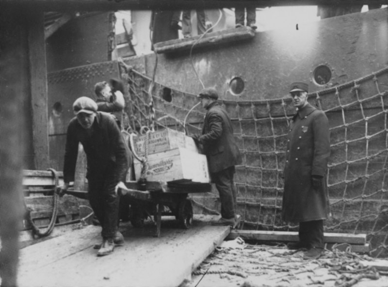Officials remove illegal liquor from a ship docked at the Grand Trunk Wharf in Portland Harbor in the 1920s. Prohibition became law nationwide with the 18th Amendment in 1919.