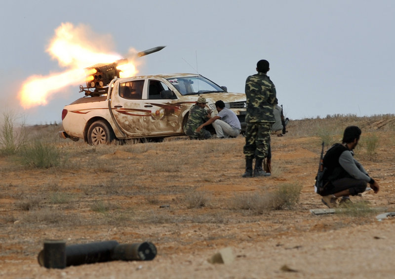 Libyan revolutionary fighters launch a missile during an attack Saturday on the city of Sirte, where forces loyal to Moammar Gadhafi are still entrenched.