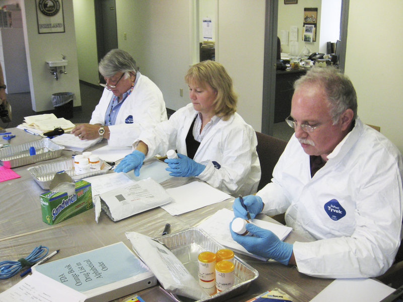Volunteer pharmacists, from left, Bill Miller, Kerry Kenney and Milton Stein inventory drugs to be discarded in 2009. A collection event will be held Oct. 29 at sites in Maine.