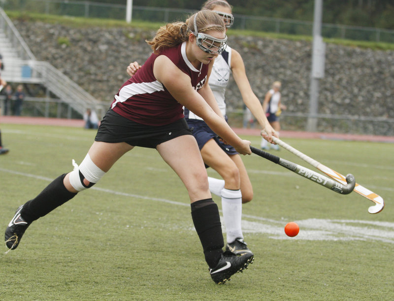 Maggie Norton of Greely keeps her eyes on the ball while attempting to hold off a Yarmouth defender during their Western Maine Conference game at Yarmouth High.