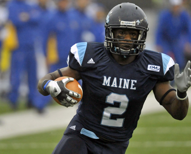 Pushaun Brown looks downfield on his way to a 26-yard touchdown run in the first quarter, one of three TD runs for Brown to help Maine win its conference opener.