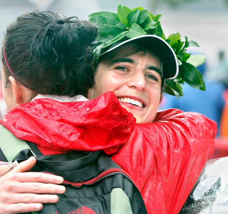 Women's marathon winner Stephanie Crawford of Dover, N.H., celebrates after winning the Maine Marathon a second time, this year in 3 hours, 7 minutes, 8 seconds.