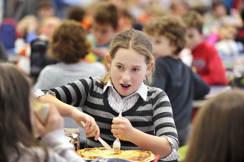 Wentworth Intermediate School student Grace Murphy enjoys a pizza in this February file photo. Those interested in a plan to replace the school can meet soon to discuss it, a reader says.