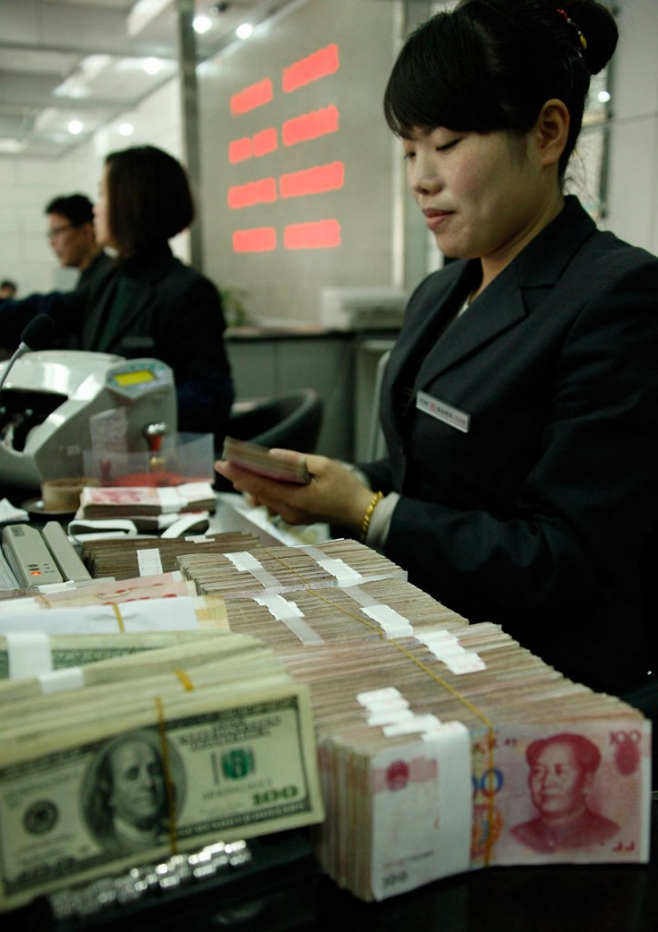 A clerk counts money at a Bank of China in Huaibei. Maine Republican Sen. Olympia Snowe is a co-author of a key part of the China currency manipulation legislation. A final vote on the bill could come Thursday.