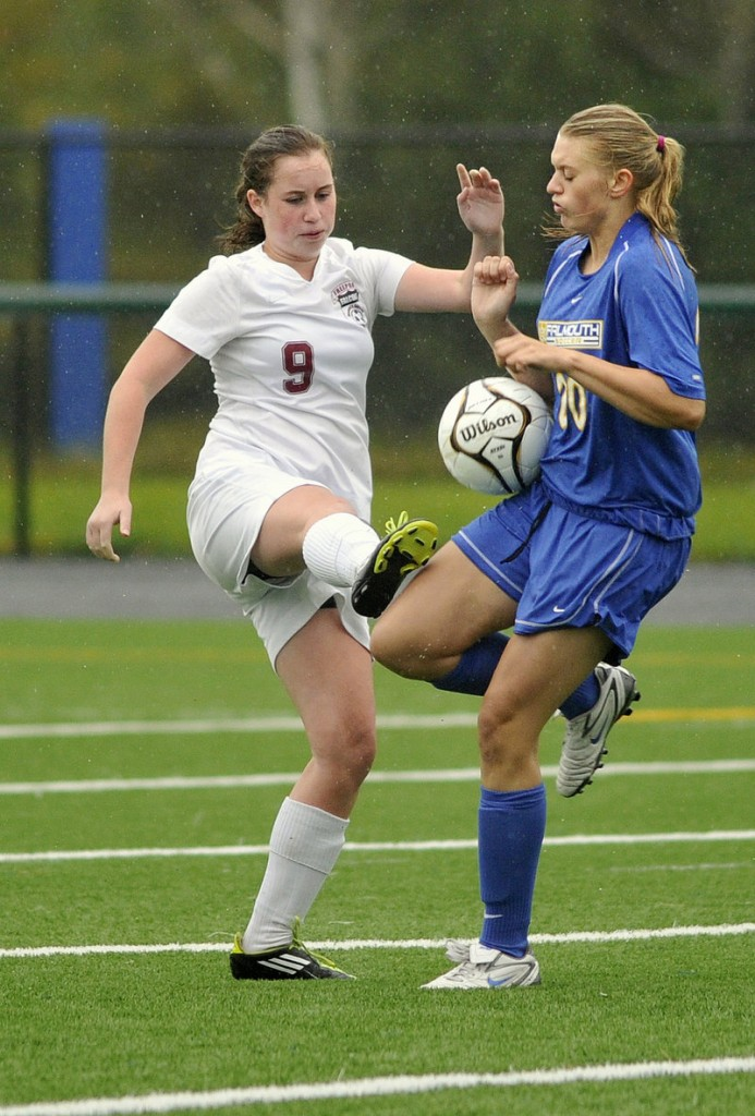 Maddie Skop of Falmouth, right, blocks a pass by Livvy Dimick of Freeport during Falmouth's 6-1 victory in a Western Maine Conference game Tuesday.