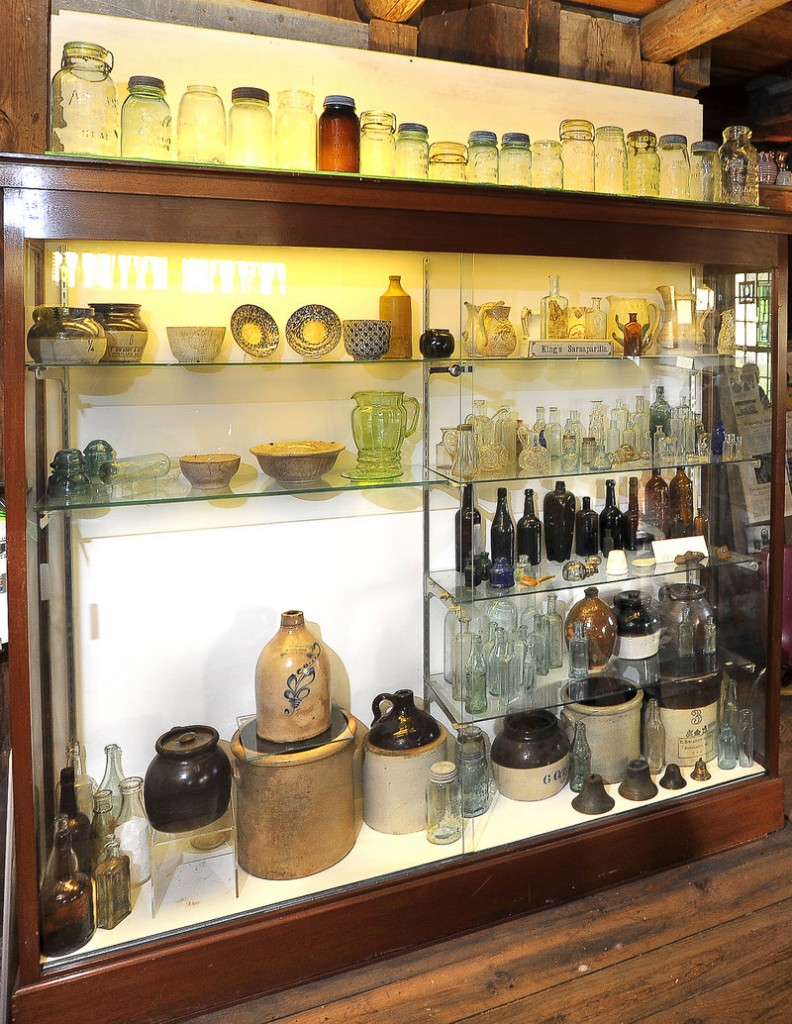 This case at the Maine Antique Bottle and Glass Museum in Bridgton contains many underwater and dig finds such as clay jugs, ink wells, salt shakers and bottles found in or near the Saco River, Androscoggin River and Stevens Brook.
