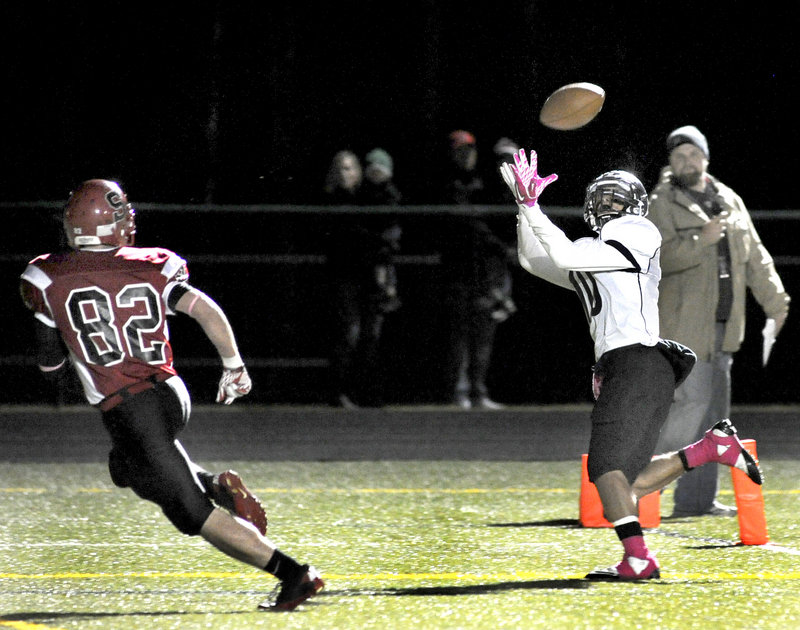 Renaldo Lowry of Deering hauls in a touchdown pass ahead of Conor McCann of Scarborough – the second score for the Rams in a 14-7 victory Thursday night.