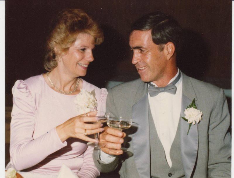 Billy Lambert and his wife, Cecelia, share a toast at their daughter's wedding in 1984. Mr. Lambert died Tuesday at age 71.