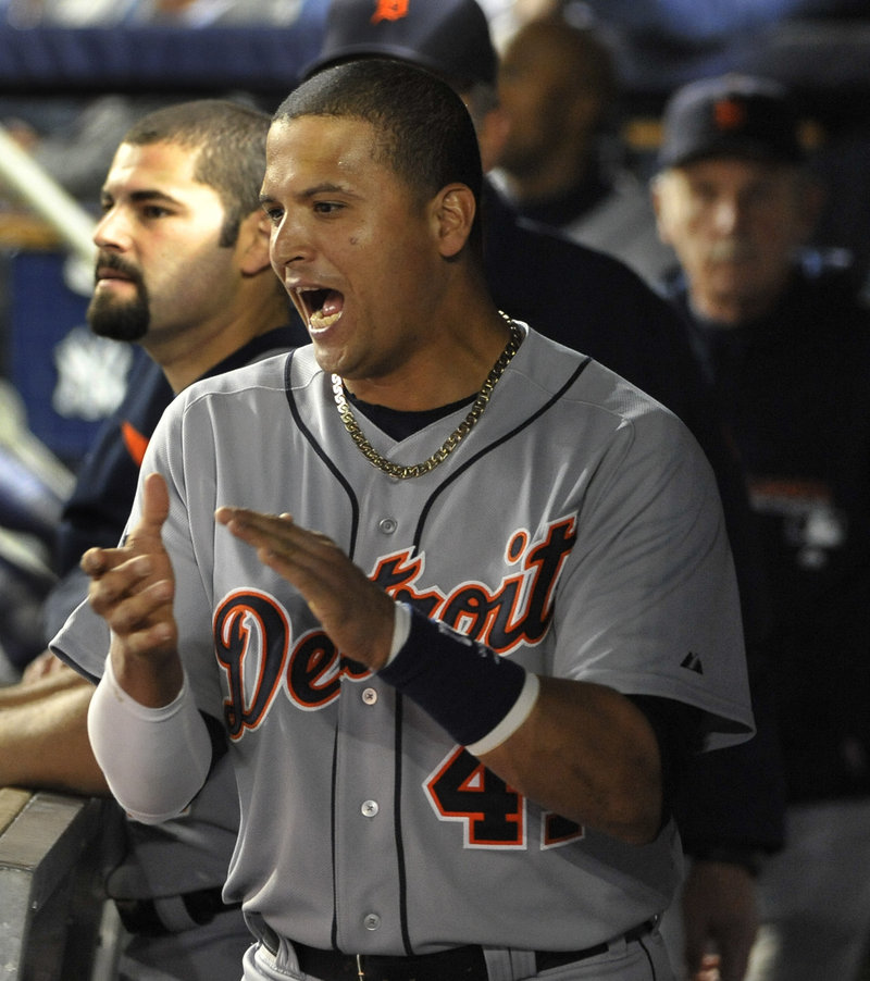 Victor Martinez of the Detroit Tigers celebrates in the dugout Thursday night after teammate Don Kelly homered in the first inning of the 3-2 victory against the New York Yankees in Game 5.