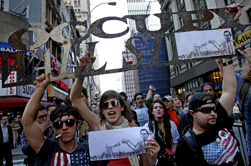 The Associated Press Occupy Wall Street marchers demonstrate Oct. 5 in New York.