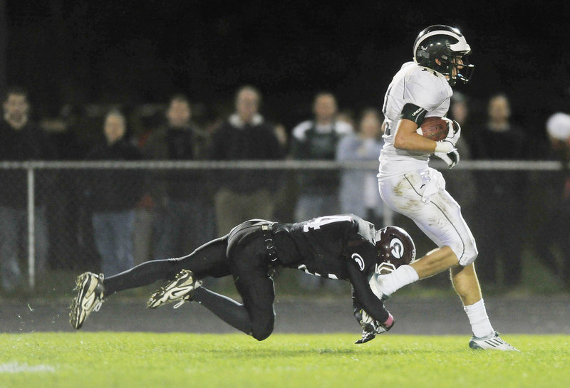 Joe Jackson of Gorham makes a touchdown-saving tackle Friday night, bringing down Cam Cooper of Bonny Eagle at the Gorham 1 after Cooper hauled in a long pass. But the Scots scored soon after and went on to win, 29-22.