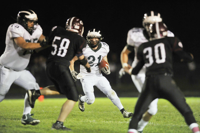 Nick Adkins, who gained 90 yards for Bonny Eagle, looks for a way around the Gorham defense Friday night during the 29-22 victory against the Rams.