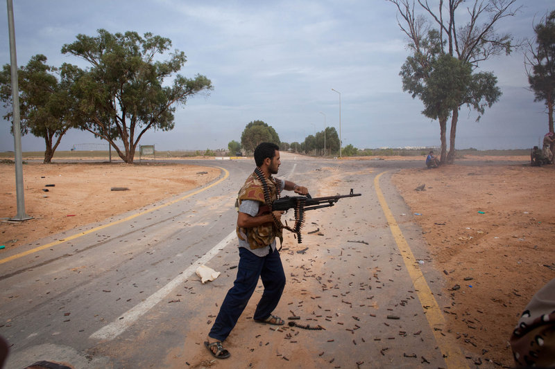 Libyan revolutionaries fire toward pro-Gadhafi forces in Sirte, Libya, on Saturday. Scattered resistance has stalled a rebel takeover of Sirte, under siege for weeks.