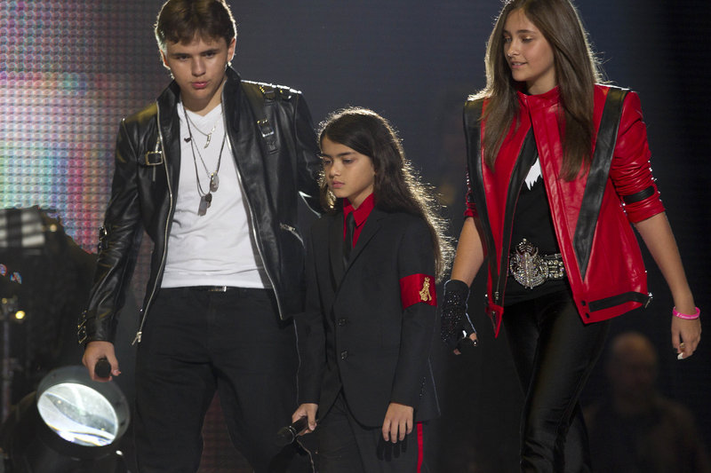 """From left, Prince Jackson, """"Blanket"""" Jackson and Paris Jackson arrive on stage at a tribute concert for their father, Michael Jackson, in Wales on Saturday."""