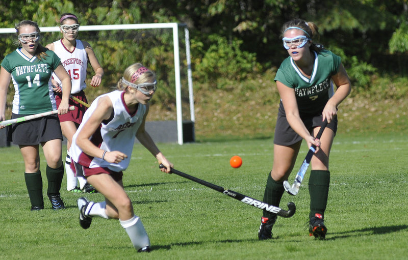 Abby Mahoney, left, of Freeport goes for the ball with Chloe Williams of Waynflete during their Western Maine Conference field hockey game Saturday. Waynflete won, 4-1.