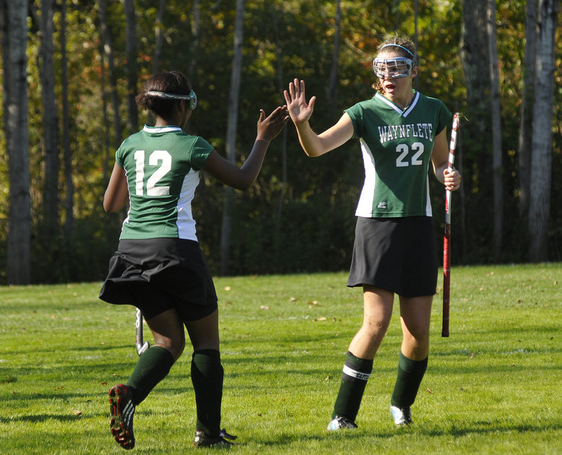 Merilla Michael, left, of Waynflete is congratulated by Jo Moore after scoring in the first half Saturday in a 4-1 victory against Freeport.