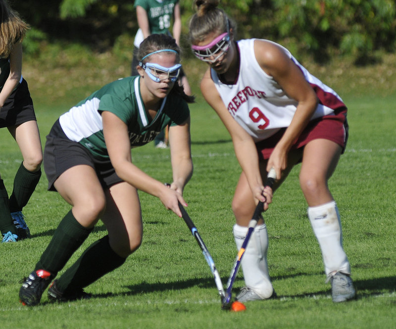 Chloe Williams, left, of Waynflete contends for the ball with Jenny Breau of Freeport during their game at Freeport High.