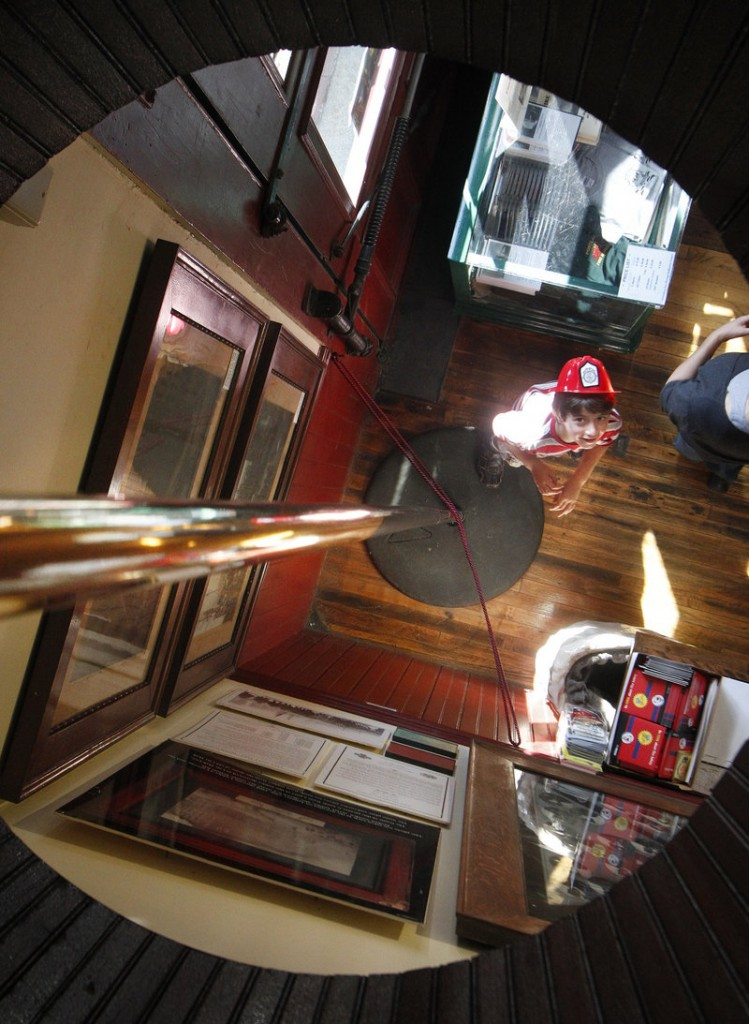 Mathias Jacobs, 7, of Falmouth, Mass., looks up at a firehouse pole during the Portland Fire Museum's ninth annual open house.